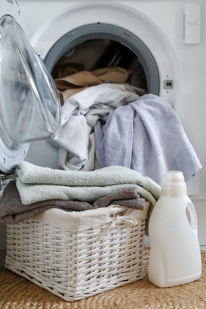 Loading a washing machine and washing clothes